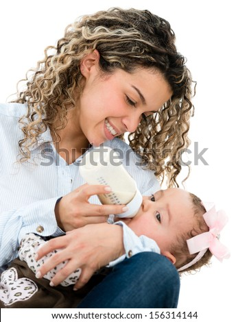 Mother feeding her baby from a bottle - isolated over white  - stock photo