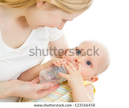 mother feeding his baby infant from bottle - stock photo