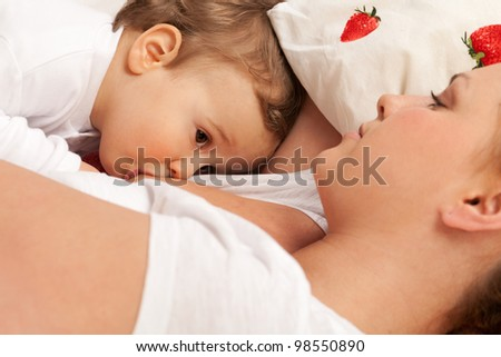 Mother feeds son with breast
