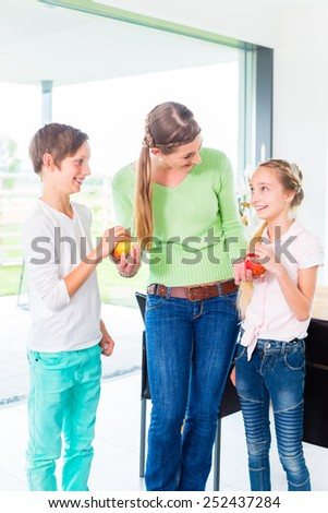 Mother giving children fresh fruits for healthy living  - stock photo