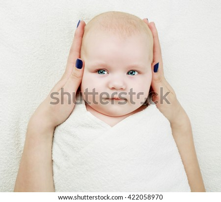 mother giving her four months old baby a massage, top view - stock photo