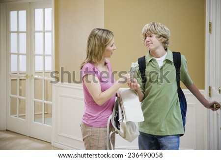 Mother Giving Lunch Money - stock photo