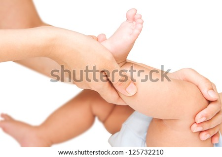 Mother hand massaging leg and foot muscle  of her baby,touch of Happiness - stock photo