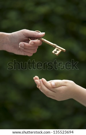mother handing key to daughter