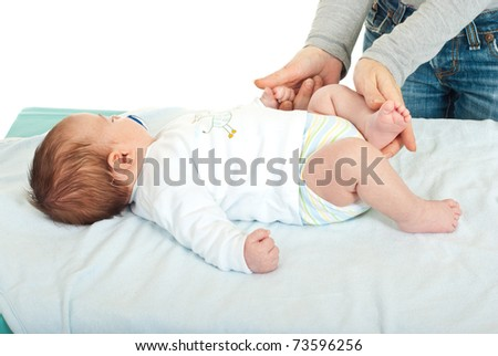 Mother hands touching her sleeping newborn baby