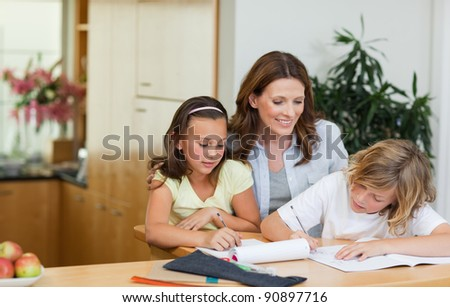 Mother having a look at her children's homework