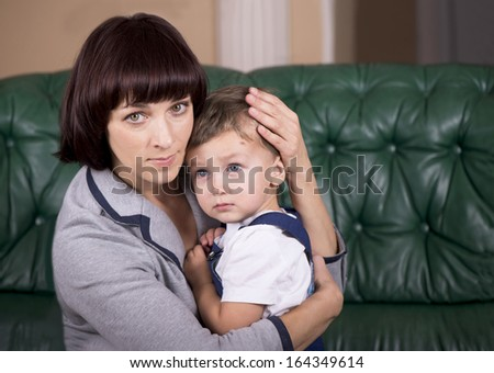 mother holding and hugging baby boy close up