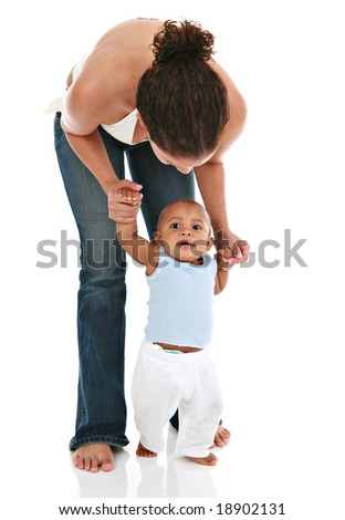 Mother Holding Baby's Hands for the First Step - stock photo