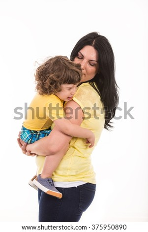 Mother holding crying toddler boy isolated on white background