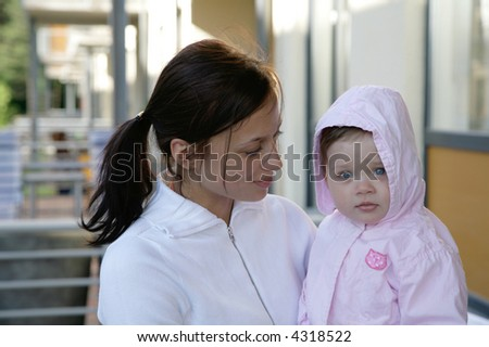mother holding cute baby girl