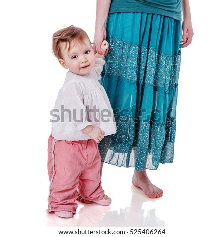 Mother holding daughter's hand isolated on white