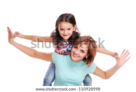 Mother holding  her little daughter on shoulders