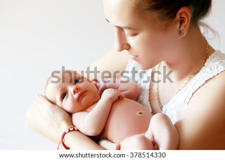 mother holding her newborn daughter close up