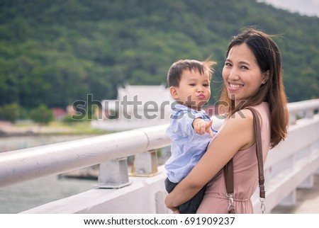 mother holding son smiling to camera