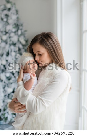 Mother holding sweet baby girl - stock photo
