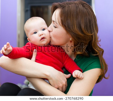 Mother holds cute 3 months baby - stock photo
