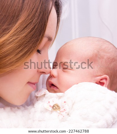 Mother holds cute newborn baby - stock photo