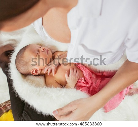 mother holds her amazing newborn  daughter