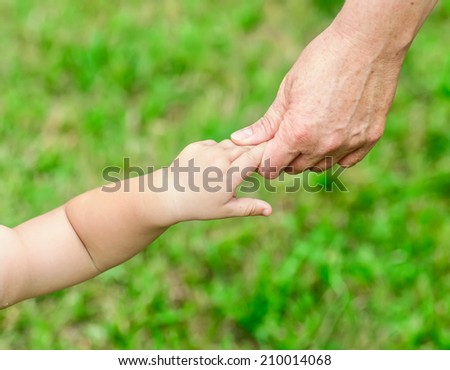 mother holds her hand baby - stock photo