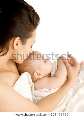 Mother hugging and kissing a sleeping baby. Happy family. Isolated on white background - stock photo