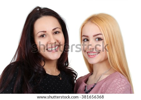 mother hugging her beautiful and beloved daughter isolated on white background - stock photo