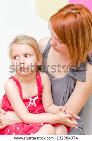 Mother hugging her sad child - stock photo