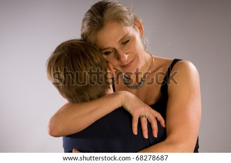 Mother hugging her son - a tender moment - stock photo
