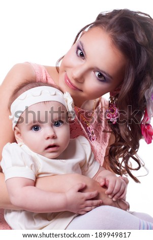 mother in a pink dress, spring makeup, with earrings soutache technique, with a daughter 6 months in a white dress. isolated on white background