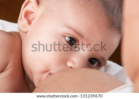 Mother is Breastfeeding her baby - stock photo
