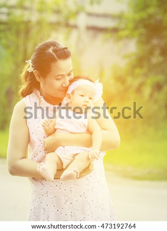 Mother is carrying baby , baby and mother feeling smile ,happy.