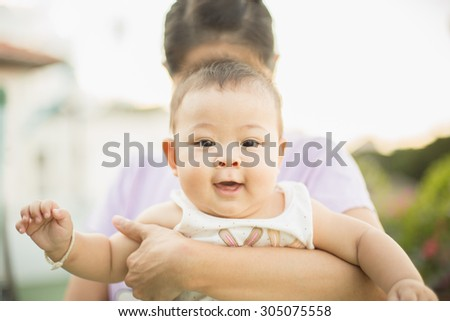mother is hiding when the baby is taking the photo - stock photo