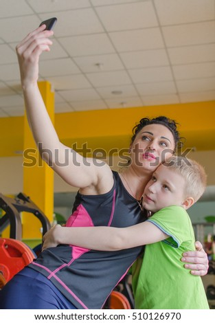 Mother is making selfie with her son
