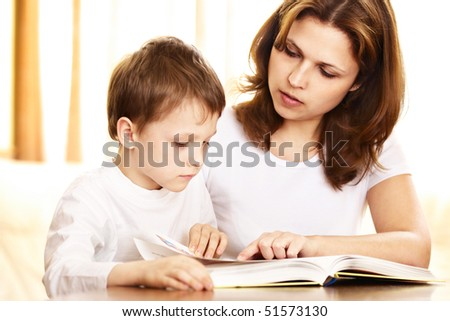 mother is teaching her child to read