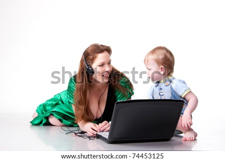 Mother is teaching her son how to work with laptop. Isolated on white - stock photo