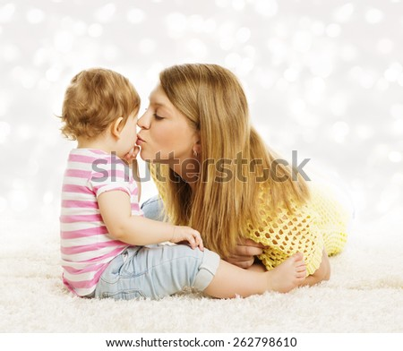 Mother Kissing Baby, Family Portrait, Mothers Kiss Little Kid, Child and Parent Love Concept - stock photo