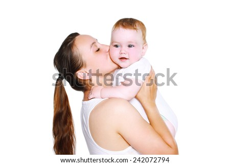 Mother kissing baby on a white background - stock photo