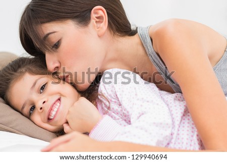 daughter in Mother bed kissing