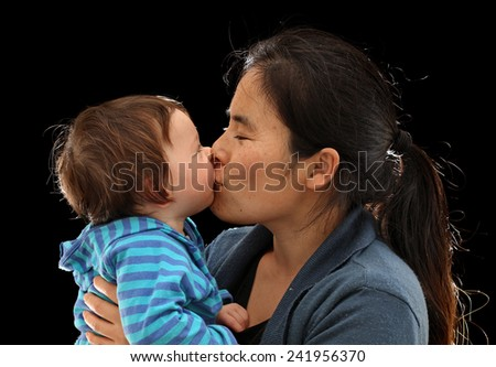 Mother Kissing her Baby Daughter