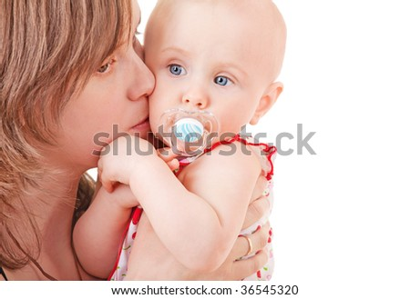 Mother kissing her baby on white background