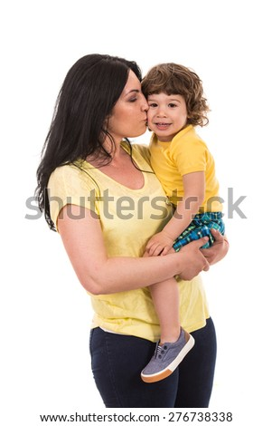 Mother kissing her toddler son isolated on white background