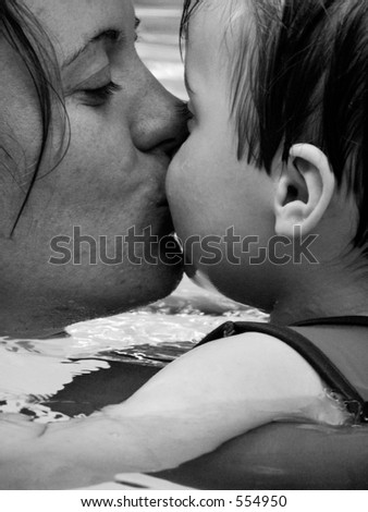 Mother kissing infant