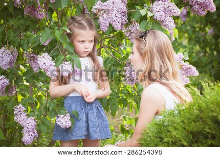 mother looking at a sad child - stock photo