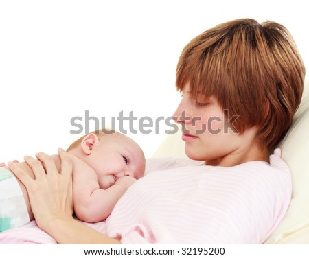 Mother looking at her newborn baby in hospital - stock photo