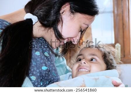 Mother loving her kid. - stock photo