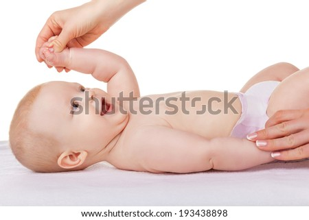 Mother makes a baby full body massage on a white background - stock photo
