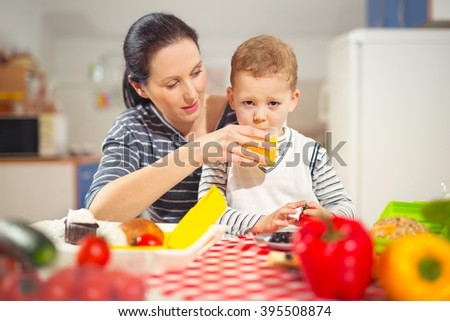 Mother making breakfast for her son in the morning