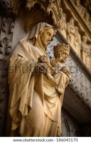 Mother Mary and Baby Jesus statue at Westminster Abbey's facade - stock photo