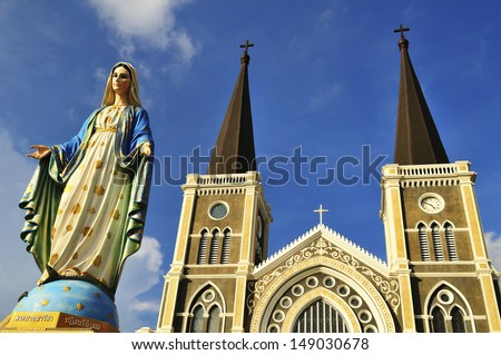 Mother Mary statue and Catholic Church   - stock photo