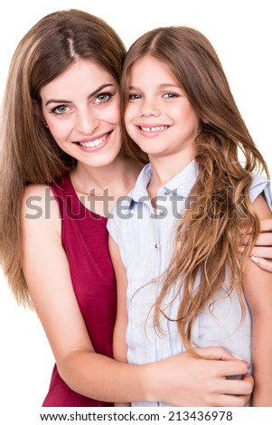 Mother or sister hugging little cute girl