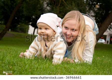 Mother outdoor playing with her daughter